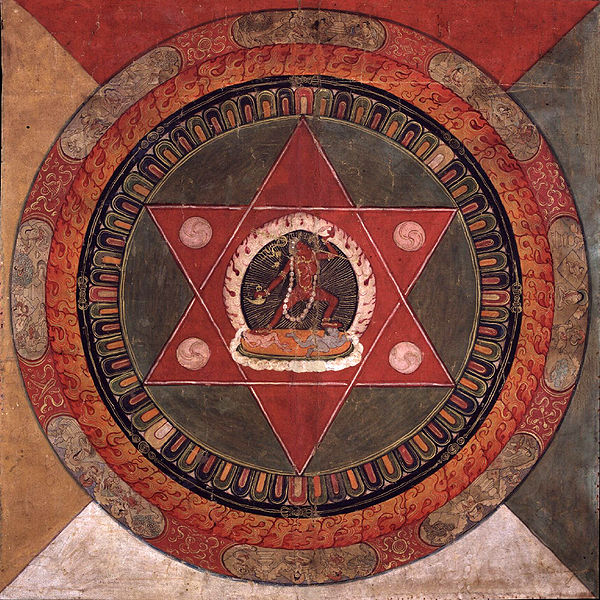 600px-Painted_19th_century_Tibetan_mandala_of_the_Naropa_tradition,_Vajrayogini_stands_in_the_center_of_two_crossed_red_triangles,_Rubin_Museum_of_Art